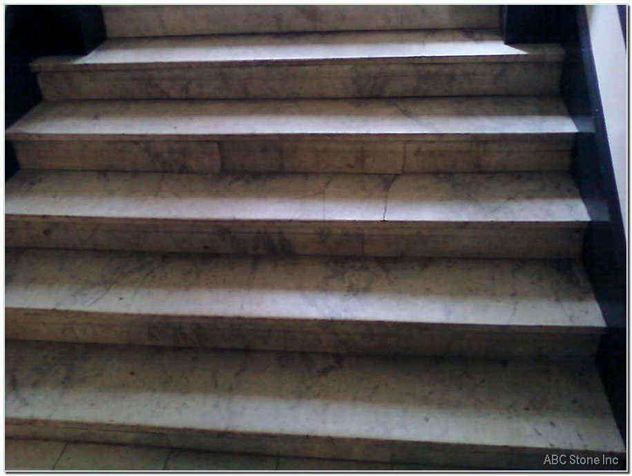 Building Foyer Marble Steps. Before Restoration
