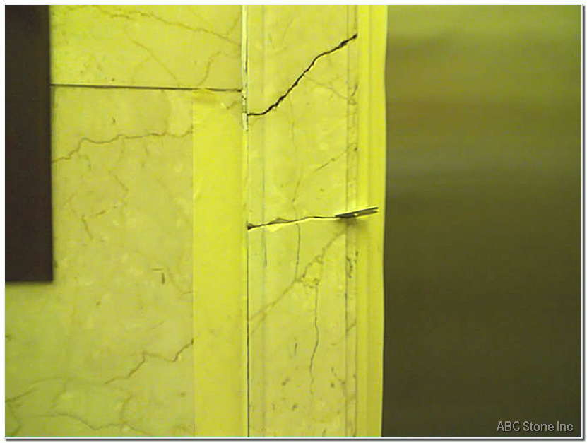 Cracked Marble Molding. Frame Around Elevator Door